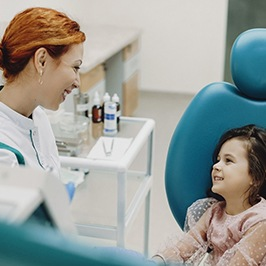 Little girl smiling at dental professional during appointment